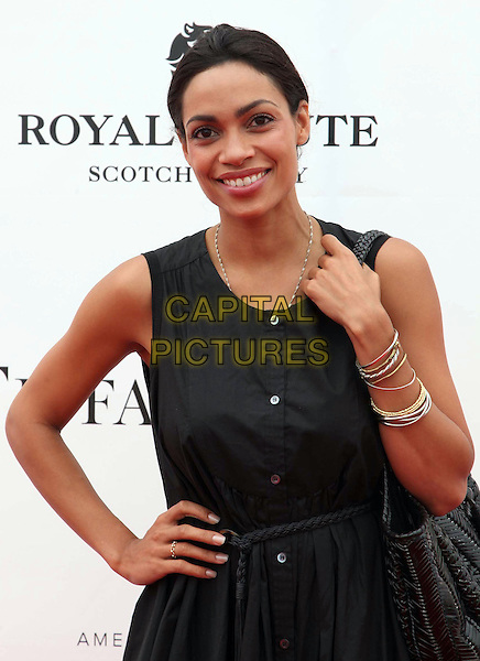 Rosario Dawson.Audi At The Foundation Polo Challenge held at the Santa Barbara Polo & Racquet Club, Santa Barbara, California, USA, 9th July 2011..half length sleeveless dress  black buttons hand on hip smiling .CAP/ADM/KB.©Kevan Brooks/AdMedia/Capital Pictures.