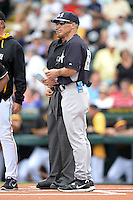 Manager Joe Girardi (28) of the New York Yankees during the lineup exchange before a spring training game against the Pittsburgh Pirates on February 26, 2014 at McKechnie Field in Bradenton, Florida.  Pittsburgh defeated New York 6-5.  (Mike Janes/Four Seam Images)