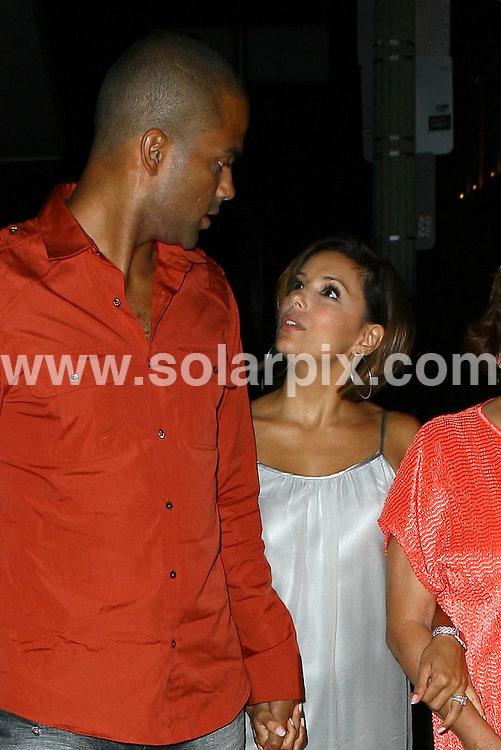 **ALL ROUND PICTURES FROM SOLARPIX.COM**.**WORLDWIDE SYNDICATION RIGHTS**.**NO PUBLICATION IN USA, DENMARK, GERMANY OR RUSSIA.Eva Longoria enjoys a family outing at Beso Restaurant in Hollywood, with her husband Tony Parker. Although the couple seemed non-plussed by the photographers, they found time to pose with two young admirers. Hollywood, USA. 16th August 2008..This pic: Tony Parker and Eva Longoria..JOB REF: 7039 LAP/Lancer        DATE: 16_08_2008.**MUST CREDIT SOLARPIX.COM OR DOUBLE FEE WILL BE CHARGED* *UNDER NO CIRCUMSTANCES IS THIS IMAGE TO BE REPRODUCED FOR ANY ONLINE EDITION WITHOUT PRIOR PERMISSION*