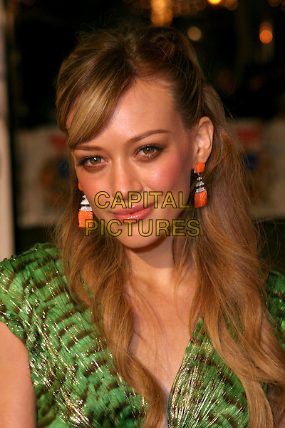 "HILARY DUFF.""Cheaper By The Dozen 2"" World Premiere - Arrivals .held at the Mann Village Theatre, Westwood, California..December 13th, 2005.Photo: Zach Lipp/AdMedia/Capital Pictures.Ref: ZL/ADM.headshot portrait orange earrings.www.capitalpictures.com.sales@capitalpictures.com.© Capital Pictures."