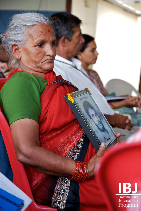 Waiting for answers. An elderly woman holds a picture of her son - a victim of an enforced disappearance - during a program to commemorate International Day of the Disappeared, International Day of the Disappeared Program, Pokhara, Nepal
