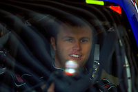 Travis Kvapil sits in his race car int he garage area a before Daytona 500 priactice, Daytona International Speedway, Daytona Beach, FL, February 13, 2010.  (Photo by Brian Cleary/www.bcpix.com)