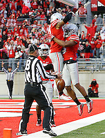 Ohio State Buckeyes running back Jalin Marshall (17) leaps into the arms of wide receiver Evan Spencer (6) after Spencer scored a touchdown during the third quarter of the NCAA football game against the Rutgers Scarlet Knights at Ohio Stadium in Columbus on Oct. 18, 2014. (Adam Cairns / The Columbus Dispatch)