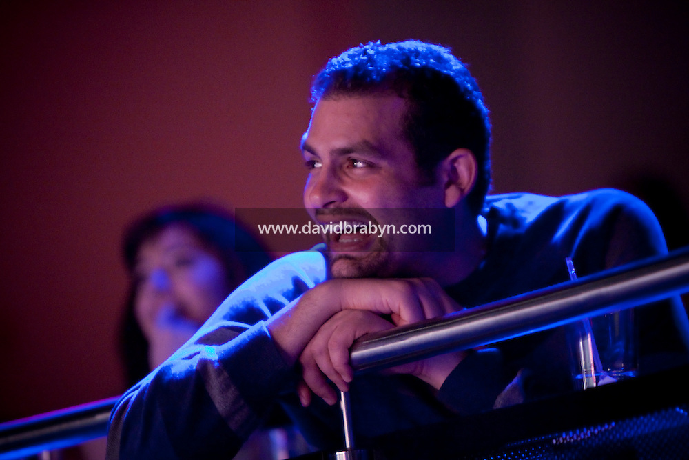 Audience member Salah Khadra, a Palestinian from Canada, watches a sketch during the 6th Annual NY Arab-American Comedy Festival in New York, USA, 10 May 2009.