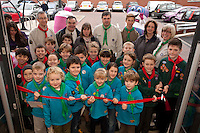 Scouts and Beavers from the 2nd and 3rd Brampton Scouts cut the ribbon to open the store
