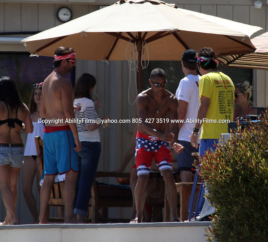 July 4th 2014  Exclusive <br /> <br /> <br /> Cuba Gooding Jr. ,  Laird Hamilton , Gabrielle Reece celebration the holiday at a beach house in Malibu California .  Cuba showing off his new hair cut mohawk was laughing dancing shirtless wearing Red white blue American flag shorts swim suit &amp; matching bandana.  Gabriel was wearing a bikini. Cuba &amp; Laird were driving around in a off road golf cart. <br /> <br /> <br /> AbilityFilms@yahoo.com<br /> 805  427 3519<br /> www.AbilityFilms.com
