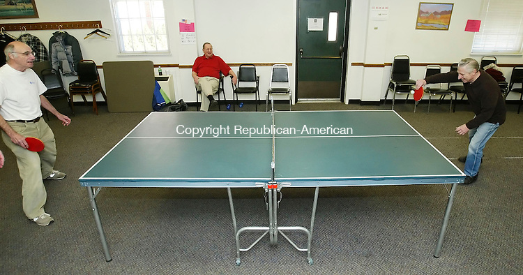 SOUTHBURY, CT, 03/06/07- 030607BZ05- With their partners out of view Barry Wolf, left, and Joe Cutrona , right, play doubles table tennis as Ron Weston watches at the Southbury Senior Center Tuesday afternoon.  The group said they play every Tuesday from 2pm to 4:30pm and welcome new members.<br /> Jamison C. Bazinet Republican-American