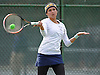 Sam Galu of Jericho returns volley during the Nassau County varsity girls' tennis doubles consolation final (third place match) at Eisenhower Park on Sunday, October 18, 2015.<br /> <br /> James Escher