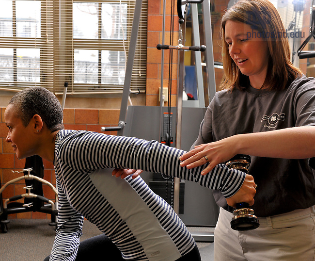 Shellie Dodd-Bell works with a client in the personal training room in Rockne Memorial...Photo by Matt Cashore/University of Notre Dame
