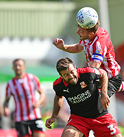 Lincoln City's Lee Frecklington vies for possession with Swindon Town's Michael Doughty<br /> <br /> Photographer Chris Vaughan/CameraSport<br /> <br /> The EFL Sky Bet League Two - Lincoln City v Swindon Town - Saturday 11th August 2018 - Sincil Bank - Lincoln<br /> <br /> World Copyright &copy; 2018 CameraSport. All rights reserved. 43 Linden Ave. Countesthorpe. Leicester. England. LE8 5PG - Tel: +44 (0) 116 277 4147 - admin@camerasport.com - www.camerasport.com