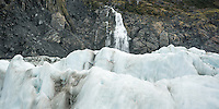 Crevasses and Victoria Waterfall on Fox Glacier, Westland Tai Poutini National Park, UNESCO World Heritage Area, West Coast, New Zealand, NZ