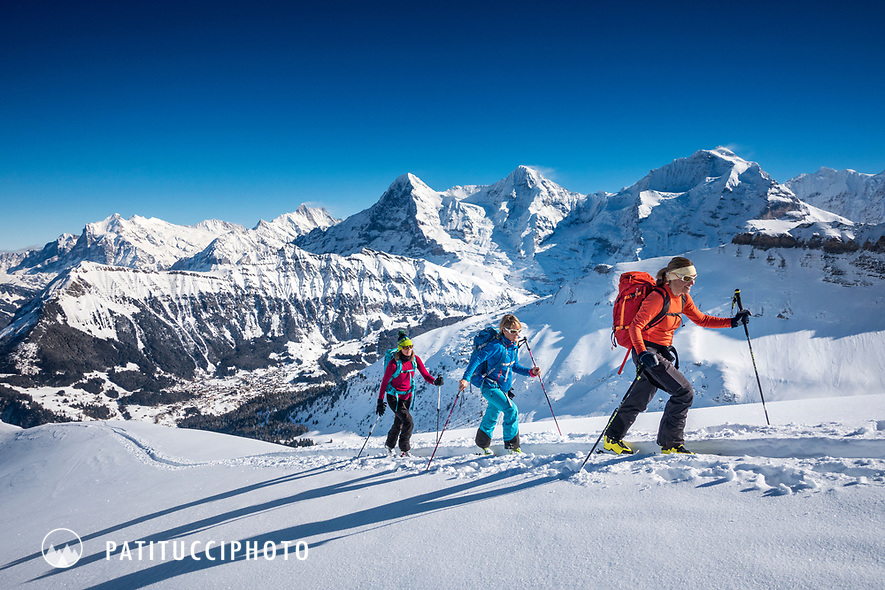Ski touring near the Lobhorn Hut, above Lauterbrunnen, with views of the Eiger, Mönch and Jungfrau, Switzerland.