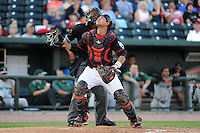 Great Lakes Loons catcher Jose Capellan (6) and umpire Malachi Moore look for a pop up foul ball during a game against the Fort Wayne TinCaps on August 19, 2013 at Dow Diamond in Midland, Michigan.  Great Lakes defeated Fort Wayne 12-5.  (Mike Janes/Four Seam Images)