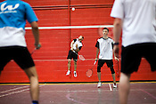 July 05, 2009. Durham, NC..Swiss national team coach, Dennis Christensen, held a badminton clinic at Peak Fitness in Durham to give local players a crash course in international level badminton, with top ranked players performing in exhibition matches.. Highly ranked Canadian National team members Nathan Choy and Nyl Yakura, background, played an exhibition match against members of the Swiss team.