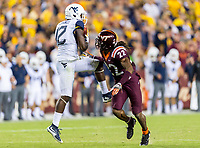 Landover, MD - SEPT 3, 2017: West Virginia Mountaineers wide receiver Gary Jennings (12) catches a pass over Virginia Tech Hokies safety Terrell Edmunds (22) for a touchdown during game between West Virginia and Virginia Tech at FedEx Field in Landover, MD. (Photo by Phil Peters/Media Images International)