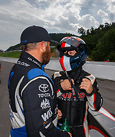 Jun 18, 2017; Bristol, TN, USA; NHRA top fuel driver Shawn Langdon (left) talks with Steve Torrence during the Thunder Valley Nationals at Bristol Dragway. Mandatory Credit: Mark J. Rebilas-USA TODAY Sports