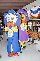 Iowa State Fair mascots Fairfield (left) and Rosetta greet people on the Administration Building porch on a rainy day at the Iowa State Fair in Des, Moines, Iowa, on Sun., Aug. 11, 2019.