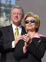 ***FILE PHOTO*** Bill Clinton Has Not Apologized To Monica Lewinsky And Claims Did The Right Thing Staying In Office.<br /> <br /> United States President Bill Clinton and first lady Hillary Rodham Clinton watch an elite military paratrooper show during the Opening Ceremonies of America's Millennium Celebration in Washington, D.C. on December 31, 1999.<br /> CAP/MPI/RS<br /> &copy;RS/MPI/Capital Pictures