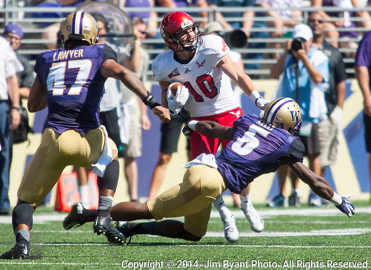 Eastern Washington Eagles' wide receiver Cooper Kupp (10) breaks a tackle by Washington Huskies'  Jermaine Kelly (6) at Husky Stadium September 6, 2014 in Seattle. Huskies out lasted the Eagles in a high powered shootout 59-52 in the third highest scoring game in Husky history.  Kupp caught 8 passes for 145 yards and scored 3 touchdowns. ©2014. Jim Bryant  Photo. All Rights Reserved