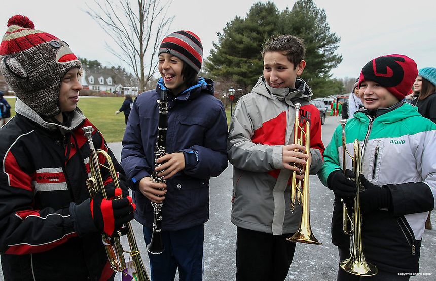 Members of the Rye Junior High Band, from left, Ben Landau, 11, Miguel Shetreet, 11, John Chiaramitaro, 12, and Boyd Crapo, 11,  ready to march in the Old-Fashioned New England Holiday parade in Rye, N.H., Sunday, Dec. 8, 2013.  (Portsmouth Herald Photo Cheryl Senter)