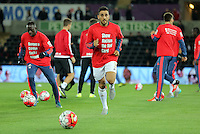"Neil Taylor of Swansea warms up wearing a ""Show Racism the Red Card"" shirt before the Barclays Premier League match between Swansea City and Stoke City played at the Liberty Stadium, Swansea on October 19th 2015"