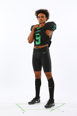 DENTON TEXAS: University of North Texas Mean Green football posed action photos.