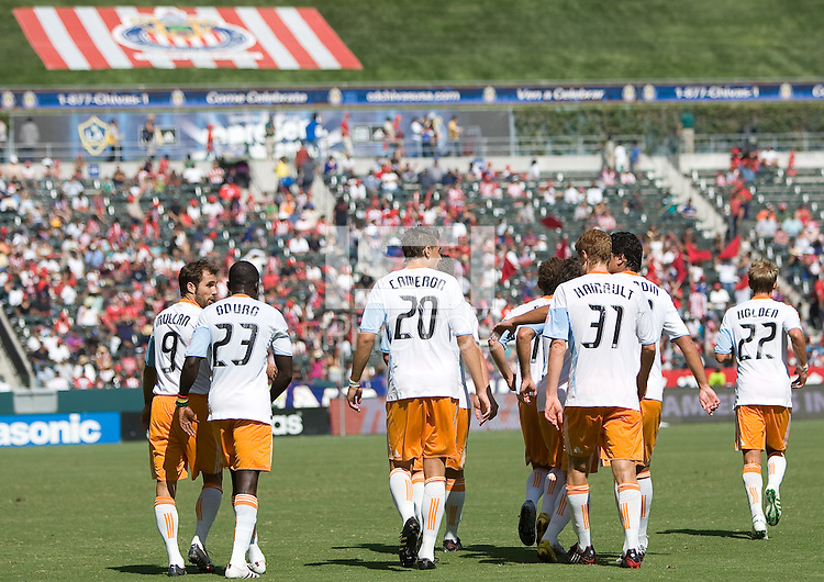 Houston Dynamo players celebrate after scoring a goal. The Houston Dynamo defeated Chivas USA 3-2 at Home Depot Center stadium in Carson, California on Sunday October 25, 2009...