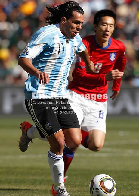 JOHANNESBURG - JUNE 17:  Carlos Tevez of Argentina (11) attacks against South Korea during a 2010 FIFA World Cup soccer match June 17, 2010 in Johannesburg, South Africa.  NO mobile use.  Editorial ONLY.  (Photograph by Jonathan P. Larsen)
