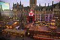 02/12/14<br /> <br /> As the sun sets, a giant Santa Claus overlooks the centrepiece of Manchester's Christmas market in Albert Square. The wooden buildings have all been built to accommodate the German style market which is spread over seven streets. <br /> <br /> ***ANY UK EDITORIAL PRINT USE WILL ATTRACT A MINIMUM FEE OF &pound;130. THIS IS STRICTLY A MINIMUM. USUAL SPACE-RATES WILL APPLY TO IMAGES THAT WOULD NORMALLY ATTRACT A HIGHER FEE . PRICE FOR WEB USE WILL BE NEGOTIATED SEPARATELY***<br /> <br /> <br /> All Rights Reserved - F Stop Press. www.fstoppress.com. Tel: +44 (0)1335 300098