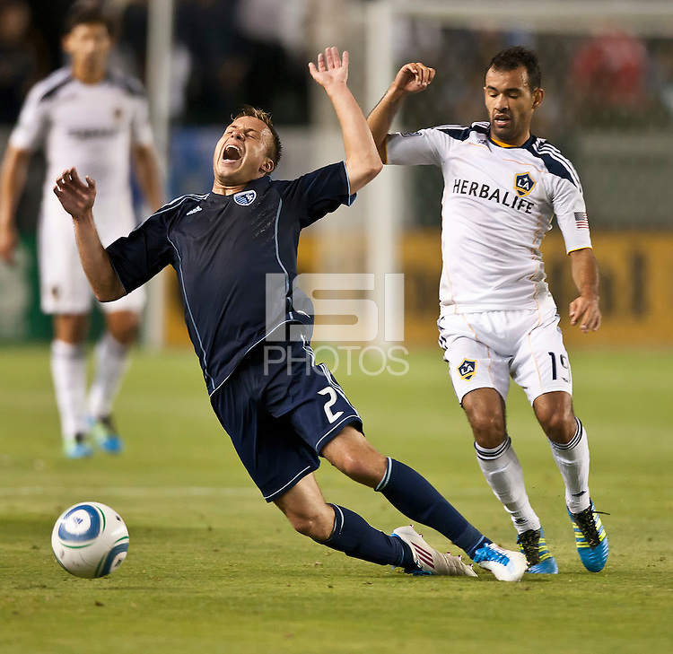 CARSON, CA – May 14, 2011: Sporting KC defender Michael Harrington (2) gets fouled by LA Galaxy midfielder Juninho (19) during the match between LA Galaxy and Sporting Kansas City at the Home Depot Center in Carson, California. Final score LA Galaxy 4, Sporting Kansas City 1.