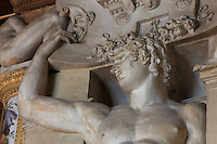 Male caryatid in carved stucco, from the frame of the fresco of the Disappointed Venus, by Rosso Fiorentino, 1535-37, in the Galerie Francois I, begun 1528, the first great gallery in France and the origination of the Renaissance style in France, Chateau de Fontainebleau, France. The Palace of Fontainebleau is one of the largest French royal palaces and was begun in the early 16th century for Francois I. It was listed as a UNESCO World Heritage Site in 1981. Picture by Manuel Cohen