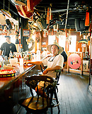 USA, Florida, fishing boat captain sitting at bar, Aj's Seafood Restaurant, Destin