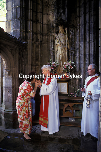 Feast day of  St Winefrides Shrine Holywell Flintshire Wales. 22 June  1980s St Winifred or Saint Winefride was a 7th-century Welsh Christian  woman, around whom many historical legends have formed. A healing spring at the traditional site of her death is now a shrine and pilgrimage site called St Winefrifdes Well,  known as the Lourdes of Wales.