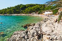 Beach in the Pakleni Islands, Mediterranean Coast, Dalmatia, Croatia. This is a photo of a beach in the Pakleni Islands on the Mediterranean coast in Dalmatia Croatia. One of the best things to do in Croatia, and in particular, Hvar Island in Dalmacija (Dalmatia region of Croatia) is hire a motor boat for the day and explore the Pakleni Islands.