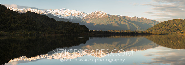 Morning at Lake Mapourika with reflections of Mount Tasman and Southern Alps, Westland Tai Poutini National Park, UNESCO World Heritage Area, West Coast, New Zealand, NZ