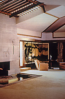 "Frank Lloyd Wright:  Aline Barnsdall ""Hollyhock House"", Hollywood, 1917. The area around the fireplace has 4 elements: fire, water (in front), stone or earth (abstract mural over the fireplace, and air (stained glass skylight above the fireplace). Photo Dec. 1987."
