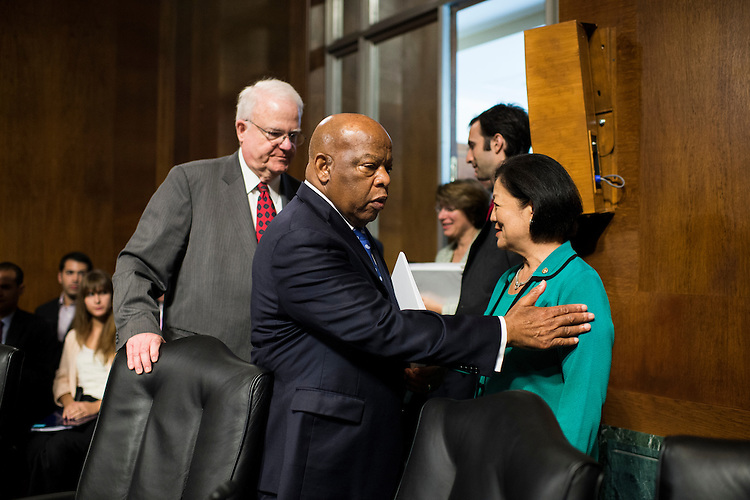 "UNITED STATES - JULY 17:  Rep. John Lewis, D-Ga., greets Sen. Mazie Hirono, D-Hawaii, as he arrives with Rep. Jim Sensenbrenner, R-Wisc., for the Senate Judiciary Committee hearing on ""From Selma to Shelby County: Working Together to Restore the Protections of the Voting Rights Act"" on Wednesday, July 17, 2013. (Photo By Bill Clark/CQ Roll Call)"