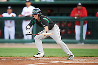 Dayton Dragons designated hitter Shane Mardirosian (13) bunts during a game against the Peoria Chiefs on May 6, 2016 at Dozer Park in Peoria, Illinois.  Peoria defeated Dayton 5-0.  (Mike Janes/Four Seam Images)