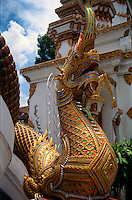 "At the entrance to many Thai temples one will see hand - crafted images of the heads of ""Naga"" - protector of Lord Buddha. Chiang Mai - Northern Thailand."