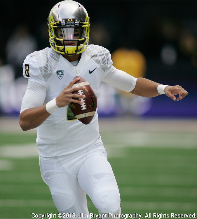 Oregon quarterback  Marcus Mariota  (8) scores a five-yard touchdown run against Washington in a college football game at Husky Stadium in Seattle, Washington on October 12, 2013.  Mariota completed 24 of 31 passes for 366 yards, rushed for 97 yards, rushed for a touchdown and passed for three touchdown in the Oregon Ducks  45-24 win over Washington Huskies.  © 2013. Jim Bryant Photo. All Rights Reserved..  © 2013. Jim Bryant Photo. All Rights Reserved.