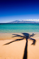 A palm shadow decorates the beach at Napili Bay, Maui.