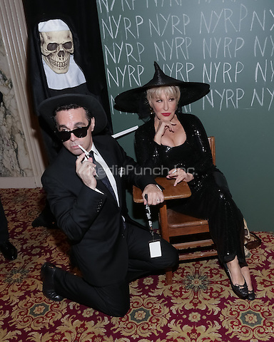 """NEW YORK, NY - OCTOBER 31 : Comedian/Writer and Actor Mario Cantone (L) and Singer/Actress Bette Midler arrive for the New York Restoration Project's 19th Annual Hulaween Gala """"FELLINI HULAWEENI"""" held at the Waldorf Astoria on October 31, 2014 in New York City.  (Photo by Brent N. Clarke / MediaPunch)"""