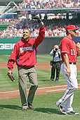 United States President Barack Obama waves to the crowd after he threw out the first pitch at the Washingon Nationals home opener, Washington, DC, Monday, April 5, 2010, to mark the 100th anniversary of the presidential tradition. William Howard Taft was the first president to do so in 1910. .Credit: Martin H. Simon / Pool via CNP