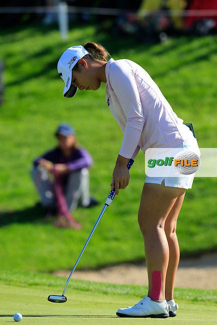 Lydia Ko (NZL) takes her putt on the 18th green during Sunday's Final Round of the LPGA 2015 Evian Championship, held at the Evian Resort Golf Club, Evian les Bains, France. 13th September 2015.<br /> Picture Eoin Clarke | Golffile