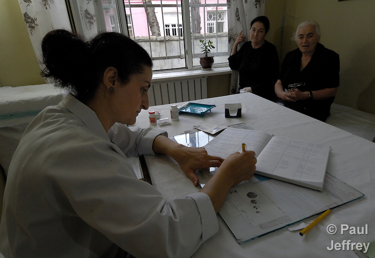 A pharmacist fills a prescription while her patient waits in the Clinic of the Georgian Patriarchate, a joint facility with the Department of Diagnostic and Internal Medicine of the Tbilisi State Medical University. .