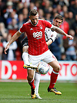 Daryl Murphy of Nottingham Forest and Chris Basham of Sheffield Utd during the Championship match at the City Ground Stadium, Nottingham. Picture date 30th September 2017. Picture credit should read: Simon Bellis/Sportimage