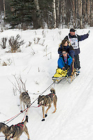 Cliff Wang w/Iditarider on Trail 2005 Iditarod Ceremonial Start near Campbell Airstrip Alaska SC