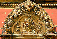 Intricate carvings on the ornate golden gate entrance to Bhaktapur Palace in Nepal
