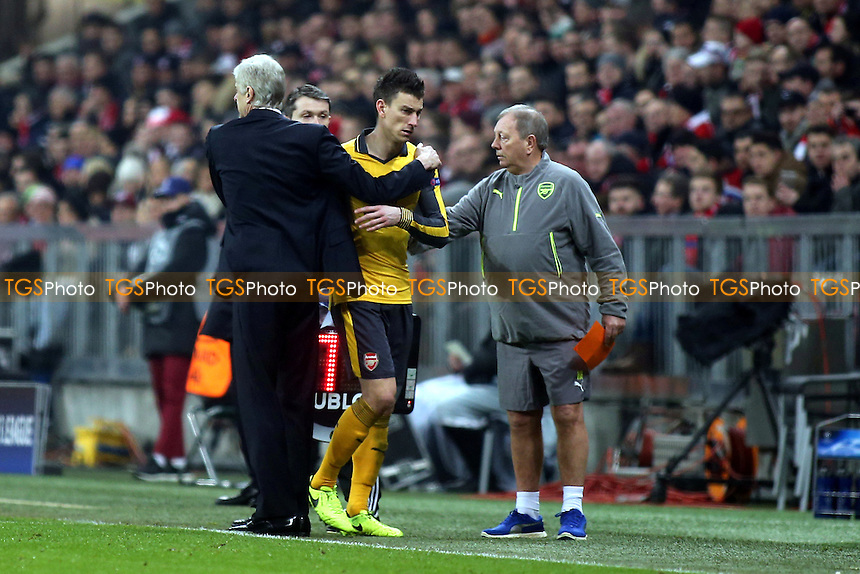 A hug from Arsenal Manager, Arsene Wenger as Laurent Koscielny of Arsenal leaves the field in the second half with an injury during FC Bayern Munich vs Arsenal, UEFA Champions League Football at the Allianz Arena on 15th February 2017