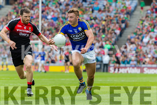 James O'Donoghue Kerry in action against Chris Barrett Mayo in the All Ireland Semi Final Replay in Croke Park on Saturday.